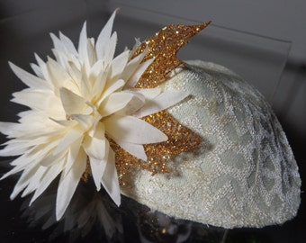 Womens' Mini Hat, Fascinator, Hair Accessory, in Cream Fabric, Lined, With Attached Gold Glittered Leaf and Matching Cream Floret