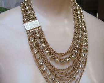 Vintage glamour 15 strand draping necklace, multi chain bead goldtone necklace, multi chain necklace bold Barclay clip dome earrings set