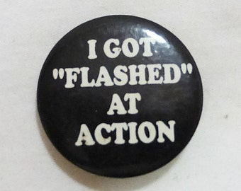 Vintage tin button pin humor i got flashed at action