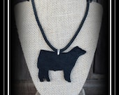 """Angus/Maintainer/Limousin X Hair On Hide show steer 3"""" wide leather pendant with cord"""