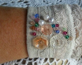 Linen and vintage lace arm cuff with swarovski crystals.