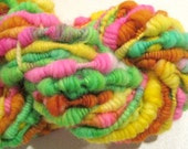 HALF OFF SALE Handspun yarn Zinnias supercoil super bulky art yarn 38 yards orange pink green yellow knitting supplies crochet supplies