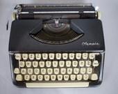 Olympia SF Black Typewriter W/ Case