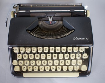 Olympia SF Black Typewriter W/ Case
