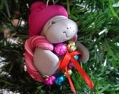 Clay Manatee with craft bulb ornament wreath