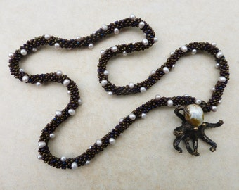 Hand Crocheted Necklace with White Freshwater Pearls and Bronze Octopus