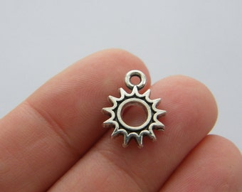 12 Sun charms antique silver tone S95