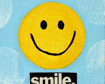 Smile. Yellow smiley face on mini canvas, yellow and blue, small, round, cut out letters, simple, children's, desk art, inspirational