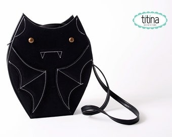 black faux leather bat bag cross body bag