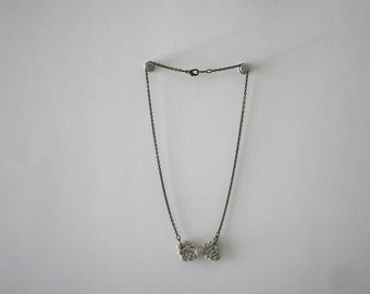 Necklace with tiny knit bow in silvery gray