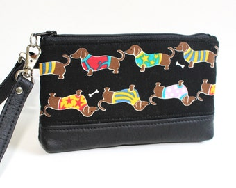 Wristlet in Black with March of the Wiener Dogs, Doxie Dogs, Dachshunds and Black Geniune Leather Bottom and Strap