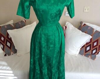 Emerald brocade 1960s vintage evening gown