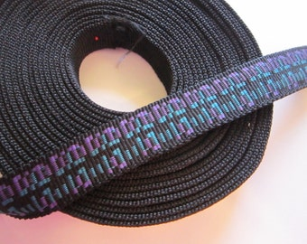 7 yards WEBBING - 1 inch wide - black with purple and blue pattern
