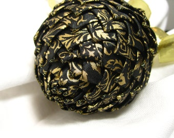 black and gold holiday season ornament, ribbon pine cone ornament