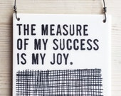 porcelain wall tile screenprinted text the measure of my success is my joy.