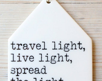 porcelain wall tag screenprinted text travel light, live light, spread the light, be the light. -yoga bhajan