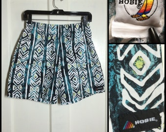 Vintage 1980's Hobie cotton Surf Board Shorts Swim Trunks size Medium Turquoise Black Tiki Petroglyph patterned rainbow label made in USA