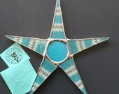 Olivia- 9 inch lacquered fabric on glass star with stained glass center