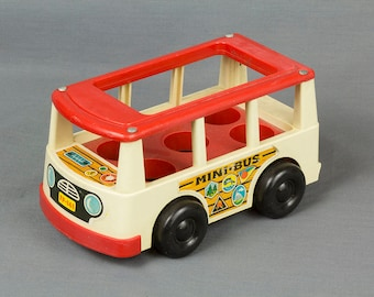 Fisher Price Mini Bus Vintage, White sides, Red Top, Hold 5 People, Excellent vintage condition. Decals are in great shape. Toy collector