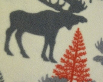 Moose in Silhouette with Red Couch Covers