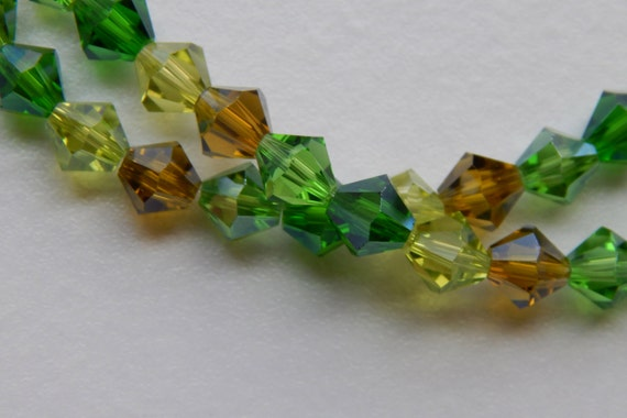 One Strand of Acrylic Jewelry Beads - 6mm Faceted Bicone Shape, Green Color Mix, Sparkle Finish, 1mm Center Hole for Stringing, 38 Pieces