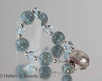 Sterling silver and lampwork bead turquoise, duck egg blue bracelet by Helen Gorick