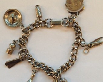 ON SALE Vintage Charm Bracelet Metal Nine Charms Scissors Wine Bottle Glass Straight Razor Compass