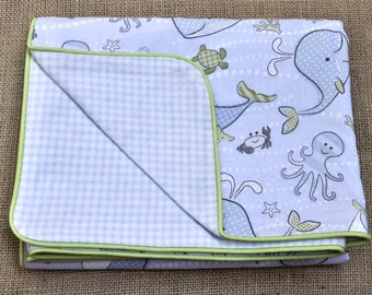 Baby blanket in sealife and gingham prints with green piping