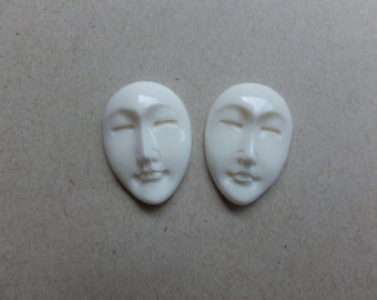 Two hand carved bone oval Moon, angel faces . 25 mm x 18 mm