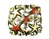 Belt buckles, vintage enameled gold tone metal with starfish