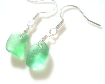 Seaham Sea Glass hook earrings of bright green drops suspended from Sterling Silver hooks - E1604 - from Seaham,  UK