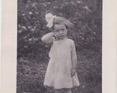 Shy little barefoot girl - RPPC photo