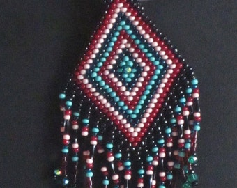 Native American beaded pendant in turquoise, black, dark red and pink