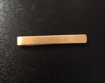 Simple bronze tie bar