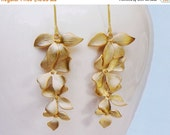 15 OFF. Flower earrings.   Wild Orchid flower cascade earrings in gold . four 4 orchids and a long earwire