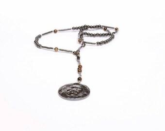 Rebel Behavior Hematite lion pendant rosary necklace