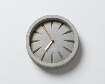 PO Concrete Clock with Brass Hands by Plywood Office