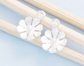 4 of 925 Sterling Silver Tiny Flower Charms 7 mm.  :th2412