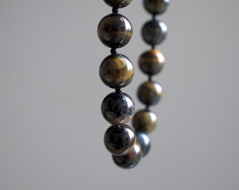 WILLOW. small tigers eye necklace with tiny black onyx. golden yellow. simple. minimal. fluid.