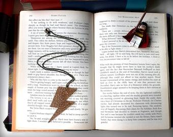 Gold glitter lightning bolt inspired by Harry Potter on long bronze chain