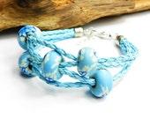 Light blue modular bracelet on strap. Modern and boho. Baby blue flowers