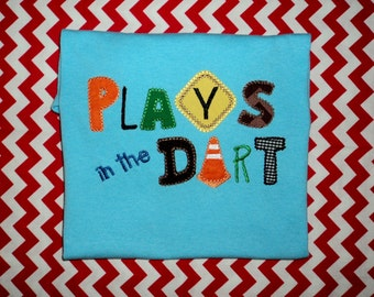 Plays in the Dirt applique on a shirt or onesie
