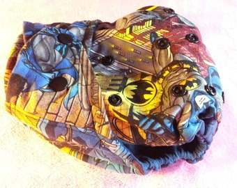 SassyCloth one size pocket diaper with batman in a city cotton print. Made to order.