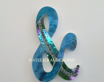 Symbol ampersand & # 5, typography with stained glass mosaic letters.