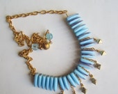 Blue Glass and Golden Necklace ./. Golden Charms and Chain Necklace ./. Collier ./. Dagger Style Beads ./. Bright Blue Beads ./. Festive
