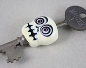 Bullseye skull on skeleton key (Item 151359)