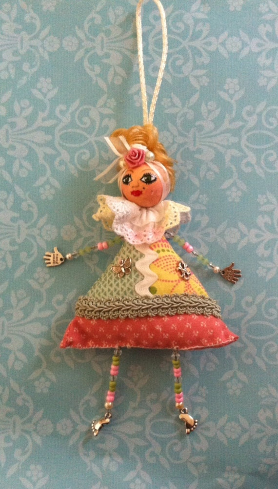 Beaded soft sculpture doll