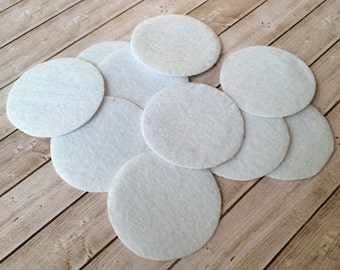 """white round felt pads with self adhesive back - 1.75"""" inch (45mm) pads mount on back of flowers for base before adhering clips & pins"""