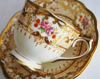 Royal Albert Teacup and Saucer, Cream and Gold Floral