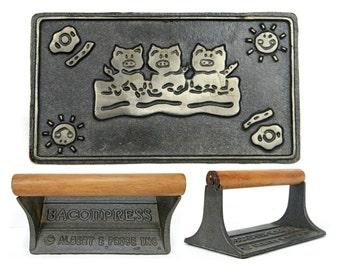 bacon press, albert price, 1940s, vintage kitchen, wood handle , cast iron, pigs, cottage, kitchen display, vintage utensil, black